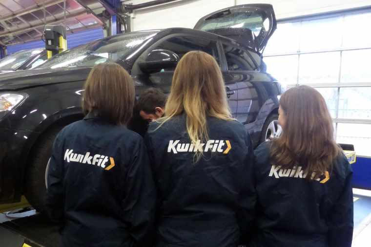 ladies in Kwik Fit overalls