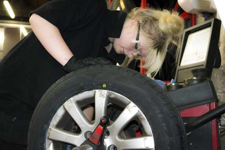 female tyre fitter