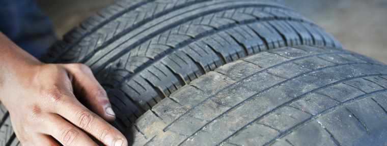 Man with car tyres
