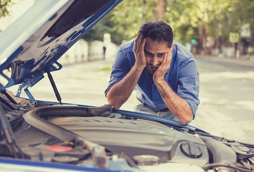 Man despairing over car