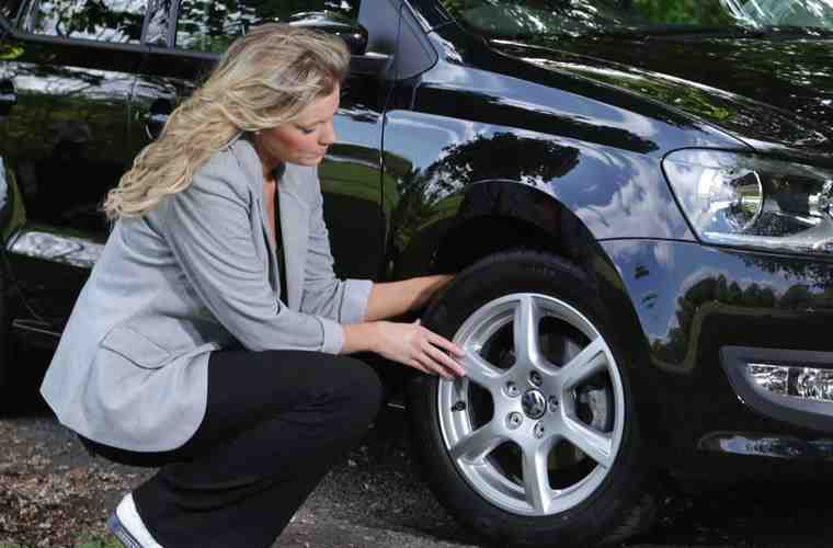 woman checking tyres