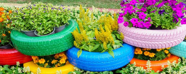 tyres filled with plants and stacked on top of each other