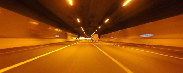 van driving through motorway tunnel