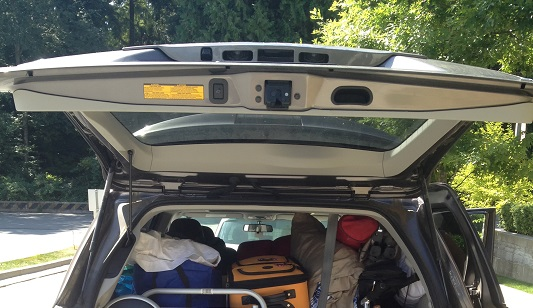 Full car boot with suitcases