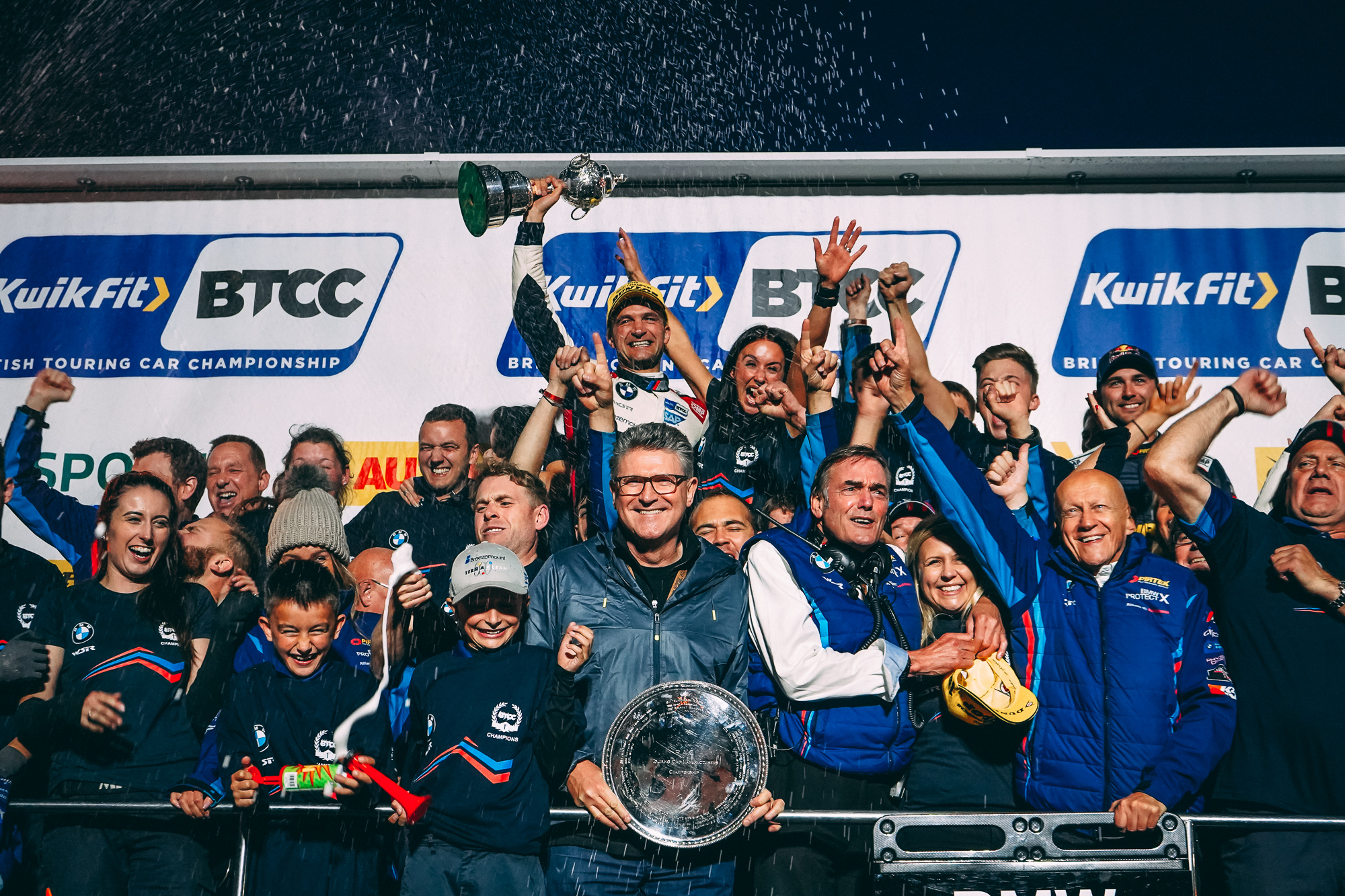 Colin Turkington and Team BMW celebrate on the podium