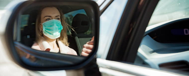 female car driver wearing a facemask