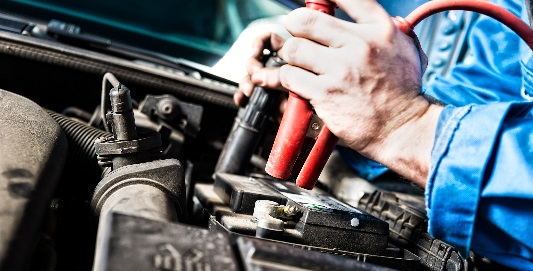 Man opening car bonnet to check battery