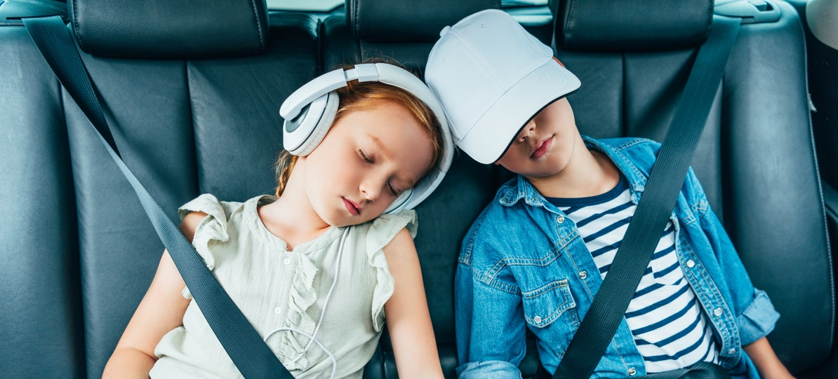 Children sleeping in the car
