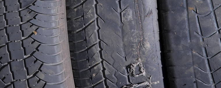 Old worn tyres with cracks and low tread depth