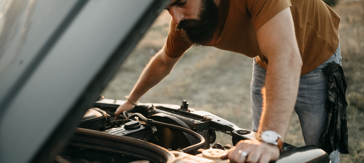 Man looking under car bonnet
